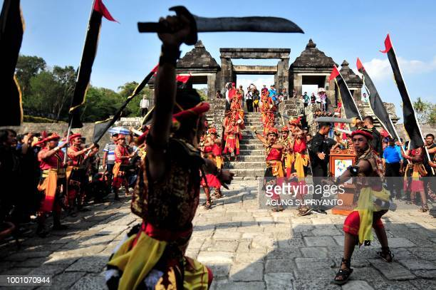 Indonesian dancers perform during a procession with the Asian Games flame to the Ratu Boko temple in Yogyakarta on July 18 2018 Indonesia will host...