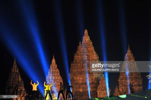 Indonesian dancers perform the Korean 'Gangnam Style' dance during a ceremony at the Prambanan temple in Yogyakarta on July 18 2018 Indonesia will...