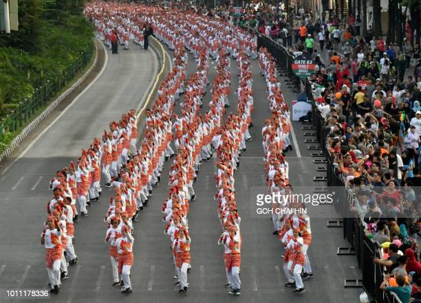TOPSHOT Indonesian dancers perform the traditional Pocopoco dance along the streets of Jakarta on August 5 2018 At least 65000 dancers have set a...