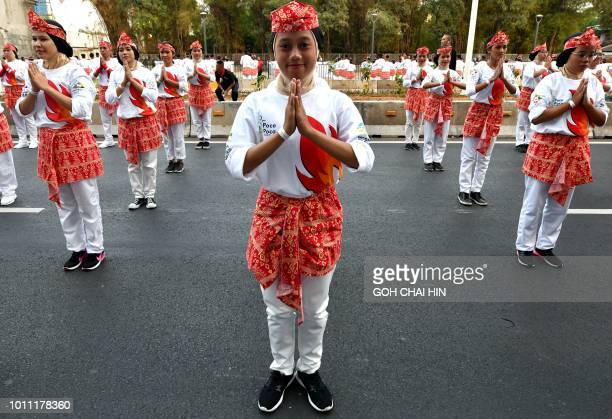 Indonesian dancers perform the traditional Pocopoco dance along the streets of Jakarta on August 5 2018 At least 65000 dancers have set a world...
