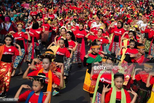 Indonesian dancers perform to celebrate the country's upcoming independence day on August 17 and to welcome the 2018 Asian Games in Jakarta on August...