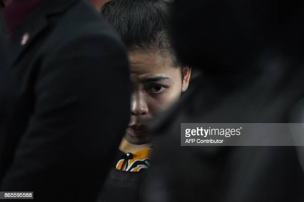 Indonesian defendant Siti Aishah looks on at the lowcost carrier Kuala Lumpur International Airport 2 in Sepang during a visit to the scene of the...