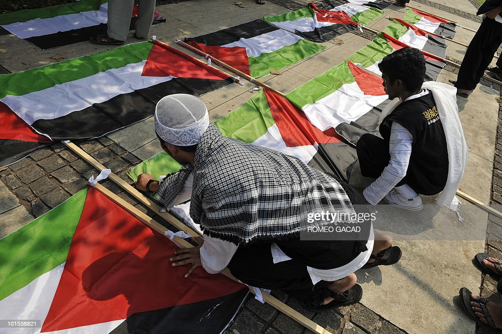 Indonesian demonstrators arrange Palestinian flags for afternoon prayers during a break from their protest outside the US embassy in Jakarta on June 2, 2010, denouncing the Israel assault on an aid flotilla bound for Gaza. World leaders demanded Israel to release detainees taken of six ships that were raided by Israel commandos in a botched operation in which nine passengers were killed, amid mounting international pressure for a full investigation of the fiasco.