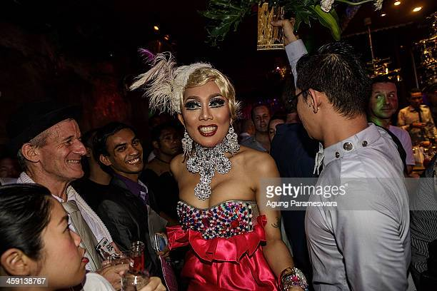 Indonesian drag queen Monica walks through the crowd during the 5th anniversary celebrations of Bali Joe Bar one of the most famous gay bars in Bali...