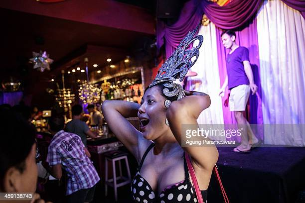 Indonesian drag queen Monica wears a head accessory durimng a practice for a special performance on the 5th aniversary of Bali Joe Bar one of the...