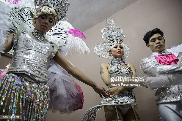Indonesian drag queens pray before their special performance for the 5th anniversary celebrations of Bali Joe Bar one of the most famous gay bars in...
