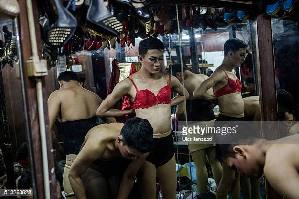 Indonesian drag queens prepare at the backstage before performing in a cabaret show on February 26 2016 in Yogyakarta Indonesia In recent weeks...
