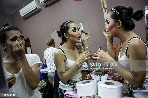 Indonesian drag queens put on their eyeliner as they prepare backstage for a special performance on the 5th anniversary celebrations of Bali Joe Bar...