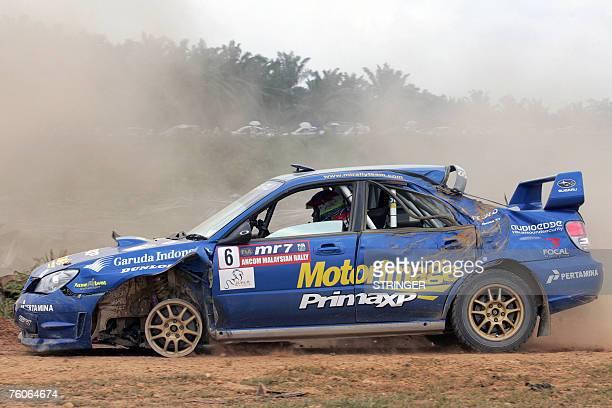 Indonesian driver Rifat Sungkar and codriver Muhamad Herkusuma of Motor Image Rally Team limp towards the finish line in their badlydamaged Subaru...