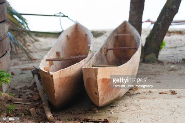 indonesian dugout canoes - raja ampat islands stock photos and pictures