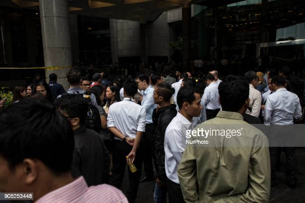 Indonesian employees try to return to their offices at Bursa Efek Jakarta or the Jakarta Stock Exchange after one part of it collapsed in Jakarta on...