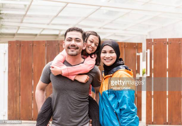 indonesian family sporty portrait - indonesia stock pictures, royalty-free photos & images