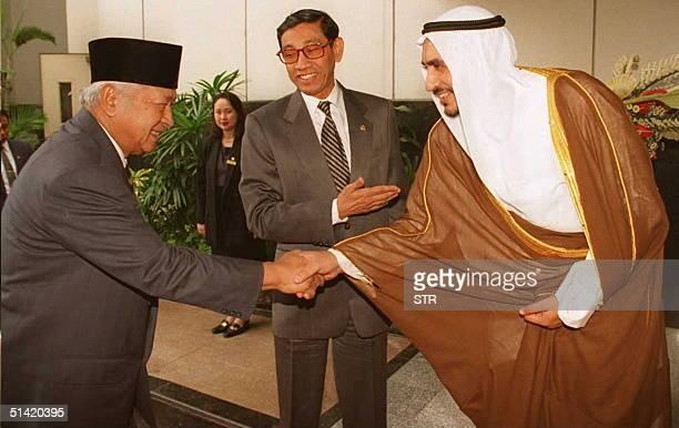 Indonesian Finance Minister Mar'ie Muhammad introduces Indonesian President Suharto to Fouad Abdullah Al-Omar of Saudi Arabia, acting President of...