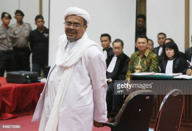 Indonesian firebrand cleric Rizieq Shihab prepares to take his seat in court to testify in the blasphemy trial of Jakarta's Christian governor Basuki...