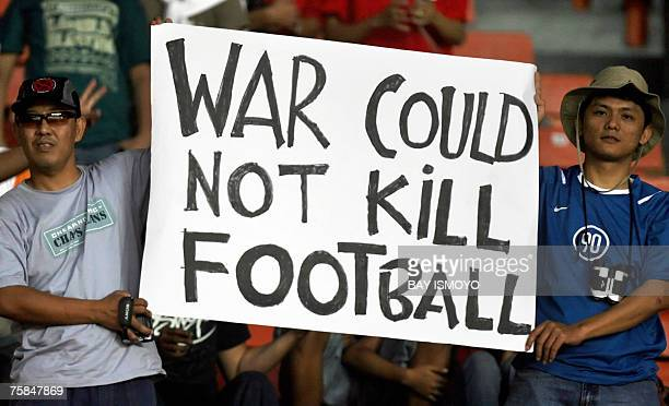 Indonesian football fans hold up a placard before the start of the Asian Football Cup 2007 final match between Iraq and Saudi Arabia at Bung Karno...