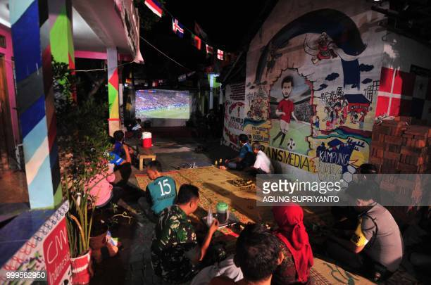 Indonesian football fans watch the final match of the Russia 2018 World Cup between France and Croatia at a football village in Yogyakarta on July 15...