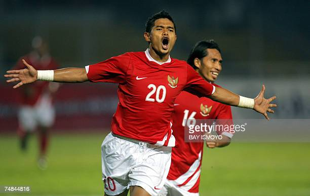Indonesian footballer Bambang Pamungkas celebrates with teammate Syamsul Bahri after scoring against Jamaica during a friendly match in Jakarta 21...