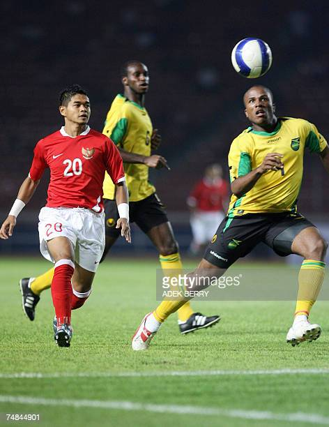 Indonesian footballer Bambang Pamungkas fights for the ball with Jamaican Jermaine Taylaor during a friendly match in Jakarta 21 June 2007 as part of...