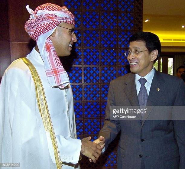Indonesian Foreign Affairs Minister Hassan Wirayuda welcomes the son of Libyan leader Moamer Kadhafi Sayef alIslam Kadhafi before their meeting in...
