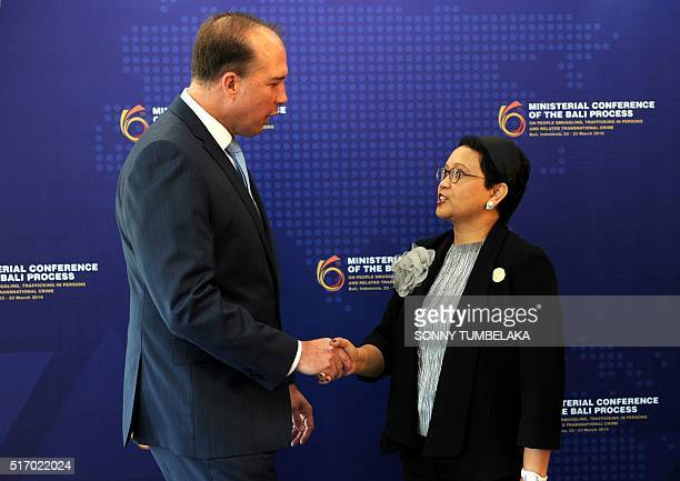 Indonesian Foreign Minister Retno Marsudi greets Australian Immigration Minister Peter Dutton as he arrives for the Bali Process conference in Nusa...