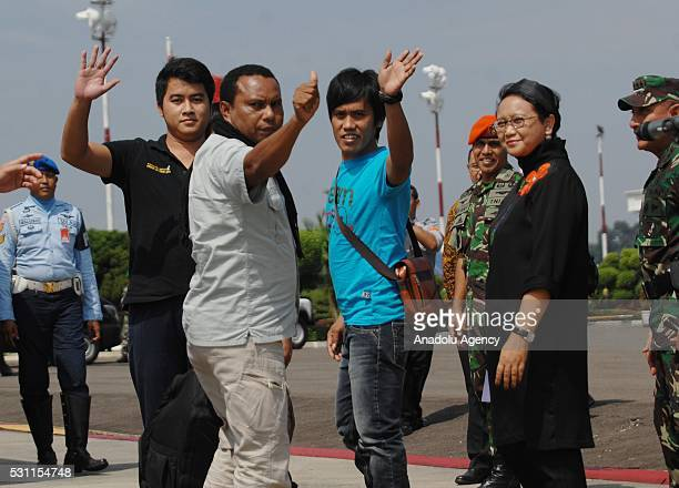 Indonesian Foreign Minister Retno Marsudi welcomes Indonesians kidnapped by Philippine rebel group Abu Sayyaf as they arrive at the Halim...