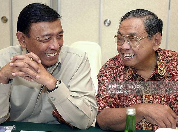 STORY INDONESIAVOTEALLIANCE Indonesian former president Abdurrahman Wahid and Presidential candidate for the Golkar Party Wiranto share a light...