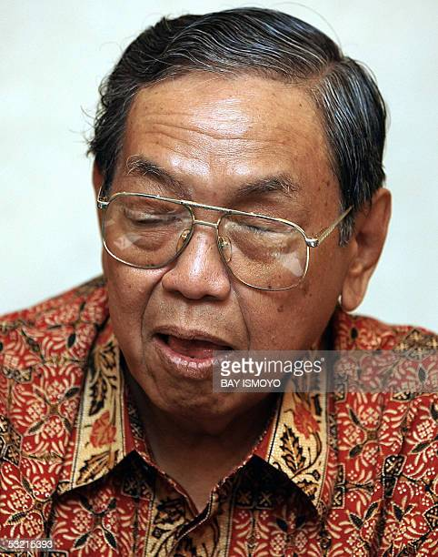 Indonesian former president Abdurrahman Wahid speaks during a press conference in Jakarta 08 April 2004 Wahid has been treated at an army hospital...