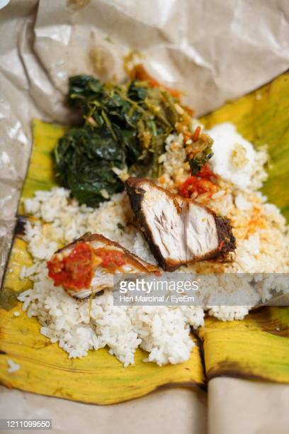 indonesian fried tuna with vegetables and rice - heri mardinal stock pictures, royalty-free photos & images