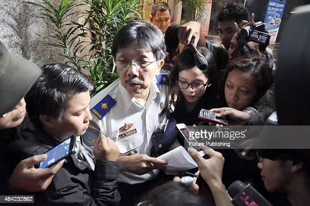 Indonesian Government official speaks to the media on August 16 2015 in Jakarta Indonesia Indonesian authorities say a plane with flight number...