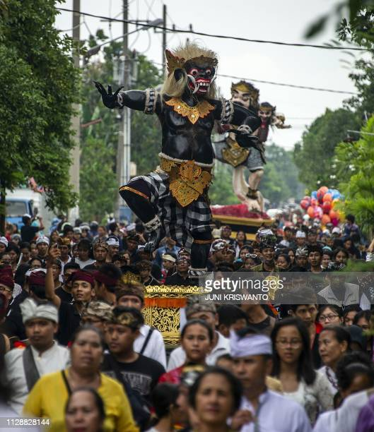 Indonesian Hindu devotees take part in the OgohOgoh effigy parade ahead of Nyepi the Day of Silence in Surabaya on March 6 2019 Hindus in Indonesia...