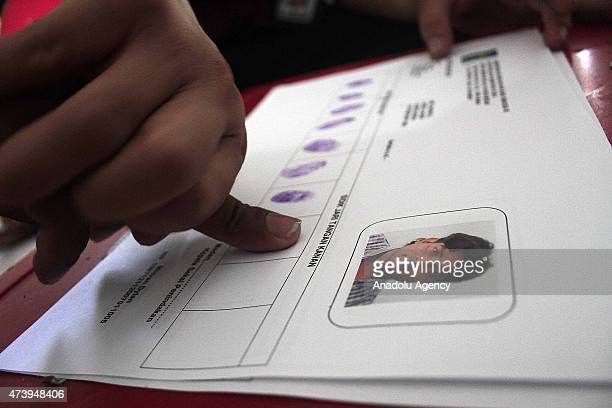 Indonesian immigration officers hold an identification procedure for Rohingya migrants in Medan North Sumatera Indonesia on May 19 More than 100...