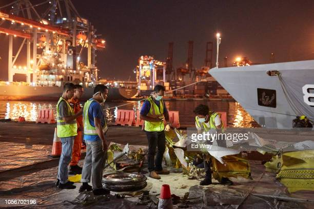 Indonesian investigators inspect wreckage recovered from Lion Air Flight JT 610 at the Tanjung Priok port on November 3 2018 in Jakarta Indonesia...