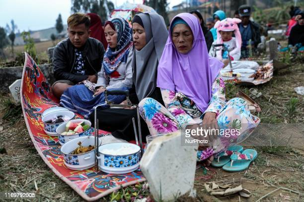Indonesian Javanese muslims gather and pray at the cemetry during a Nyadran ritual at the Jalak Ijo village in Lumajang, East Java, Indonesia on...