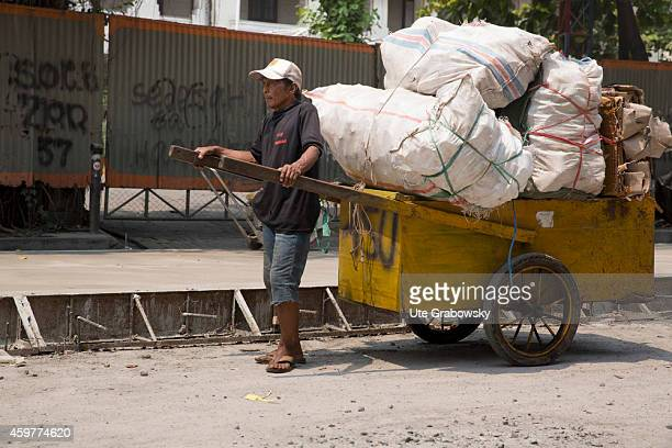Indonesian man with a loaded handcart on November 02 in Jakarta Indonesia Photo by Ute Grabowsky/Photothek via Getty Images