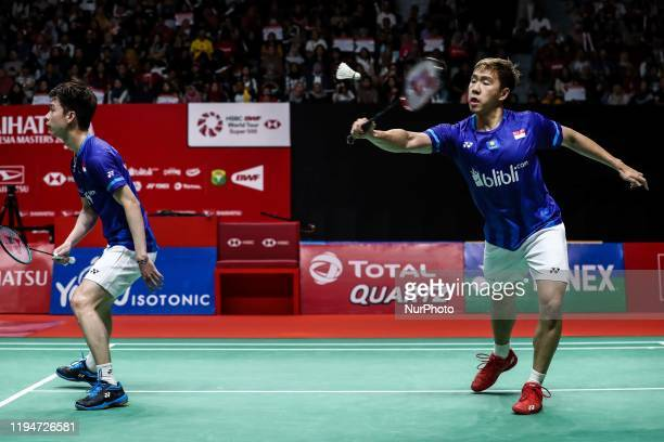 Indonesian Marcus Fernaldi Gideon and Kevin Sanjaya Sukamuljo competes in the Men Double final match against Mohammad Ahsan and Hendra Setiawan of...