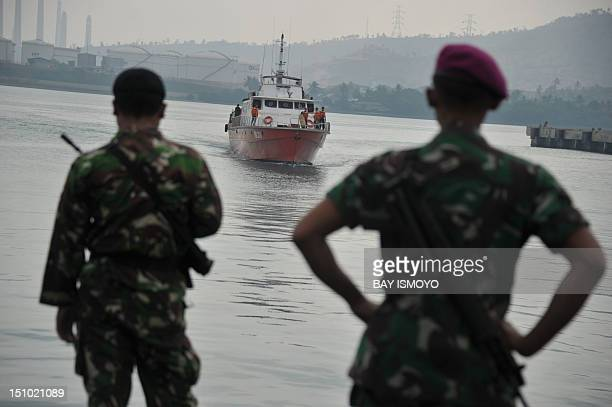 Indonesian marines look towards a rescue boat carrying asylumseekers at Merak seaport on August 31 2012 Afghans were among the 54 survivors from an...