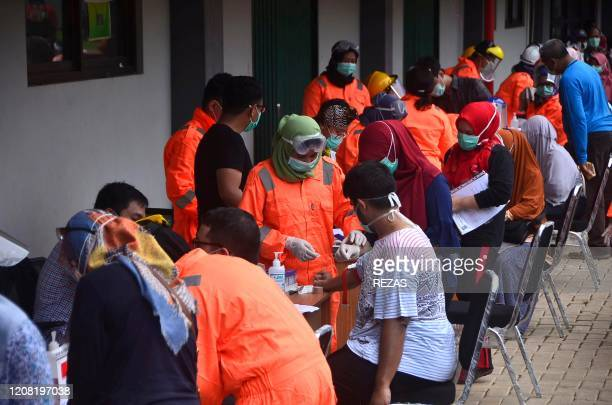Indonesian medical staff take part in a mass test for the COVID19 coronavirus at Patriot stadium in Bekasi West Java on March 25 2020