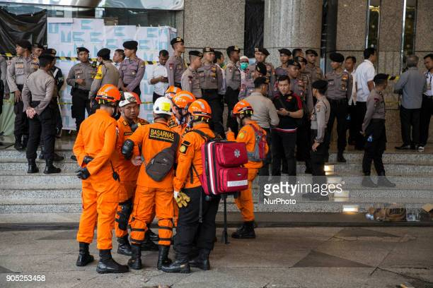 Indonesian medical team from the Indonesia Red Cross wait outside the gedung Bursa Efek Jakarta or the Jakarta Stock Exchange building after one part...