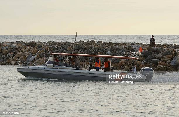 Indonesian members of a search and rescue team look for survivors from a ship that went missing with more than 100 people aboard on December 21, 2015...