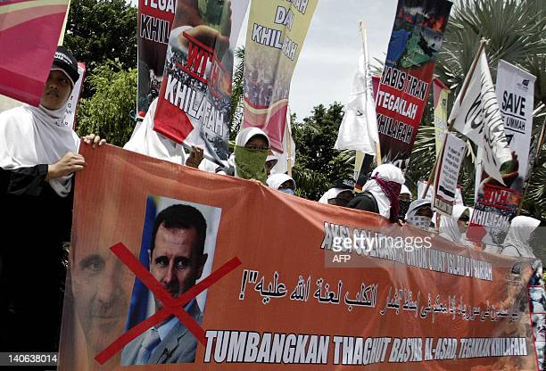 Indonesian members of the Hizbut Tahrir Indonesia attend a protest against Syria's President Bashar al-Assad in Surabaya on March 3, 2012. The Hizbut...