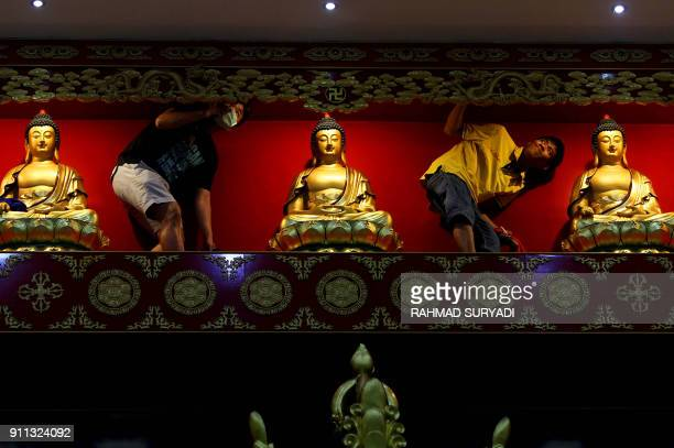 TOPSHOT Indonesian men clean a temple in Medan on January 28 2018 The Chinese new calender will start on February 16 / AFP PHOTO / RAHMAD SURYADI