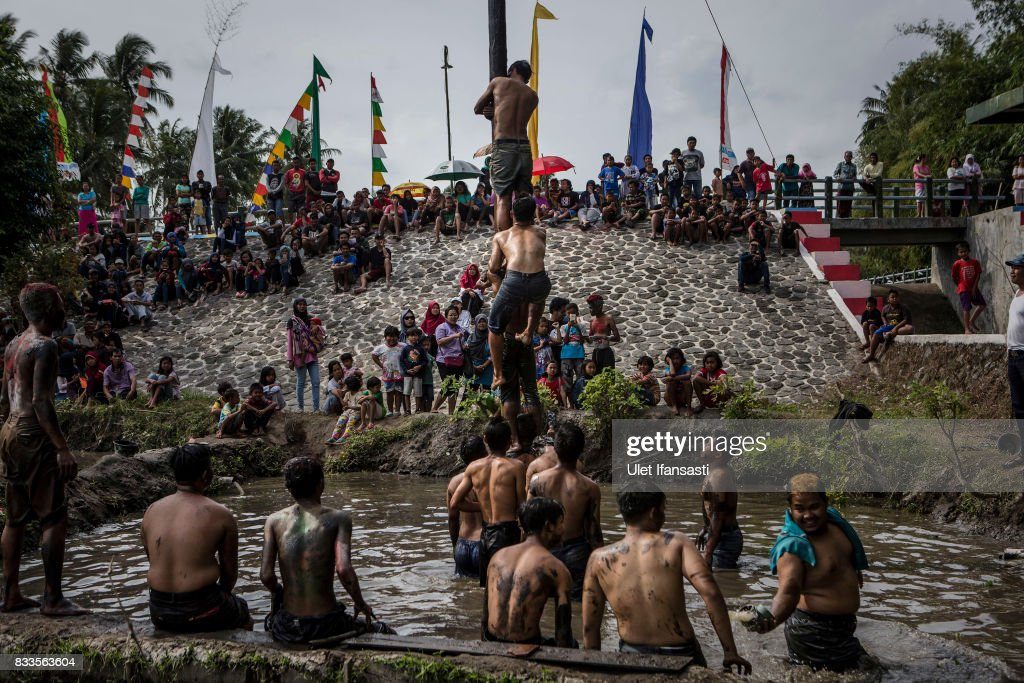 Indonesian men compete for a prize in climbing a greased pole called Panjat Pinang competition during celebrations for the 72nd Indonesia National Independence day on August 17, 2017 in Yogyakarta, Indonesia. Indonesia became an independent nation on 17th August 1945, having previously been under Dutch rule.