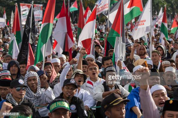 Indonesian men shout 'God is Great' at a large demonstration against the United States' decision to recognize Jerusalem as the Capital of Israel on...