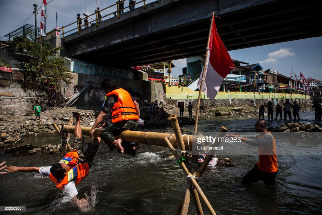 Indonesian men take part in pillow fighting competition during celebrations for the 72nd Indonesia National Independence day at Code river on August 17, 2017 in Yogyakarta, Indonesia. Indonesia became an independent nation on 17th August 1945, having previously been under Dutch rule.