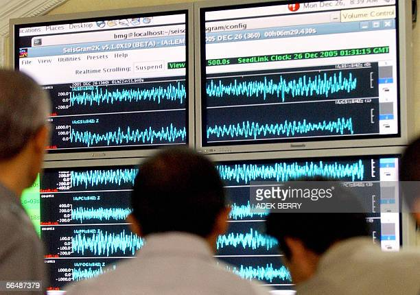 Indonesian meteorological officials check a seismograph screen during the demonstration of a simulation of tsunami early warning in Jakarta 26...