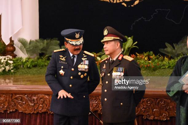 Indonesian Military Commander Hadi Tjahjanto and National Police Chief Tito Karnavian attend an inauguration ceremony at the State Palace in Jakarta...
