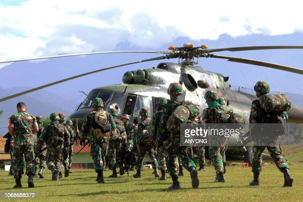 Indonesian military soldiers prepare to board a helicopter from Wamena in Papua province on December 5, 2018 to retrieve the bodies of the...