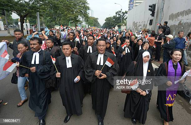 Indonesian minority religious leaders from Batak Christian Protestant Shiite Islamic and Ahmadiyah sects march toward parliament building during a...