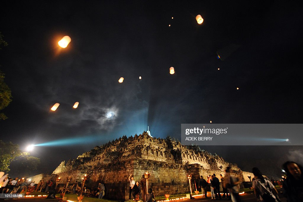 Indonesian monks hold prayers during the Vesak festival at the Borobudur temple in Magelang on May 28, 2010. Vesak day is a Buddhist holiday commemorating the birth, enlightement and death of the historical Gautama Buddha, in Indonesia is held on May 28.