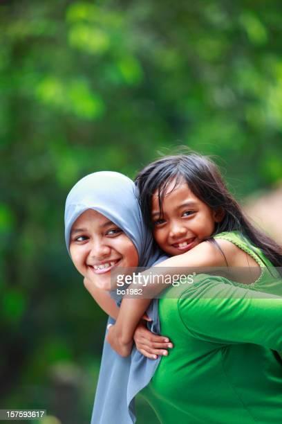 Madre y su hija Indonesia
